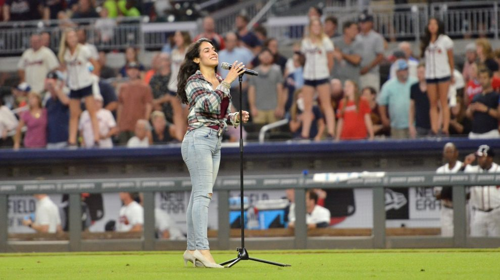 Sirena Grace singing the national anthem at the 2018 Atlanta Braves game - KSU News feature